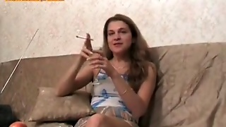 Cute Girl In Skirt Smokes And Drinks On Camera
